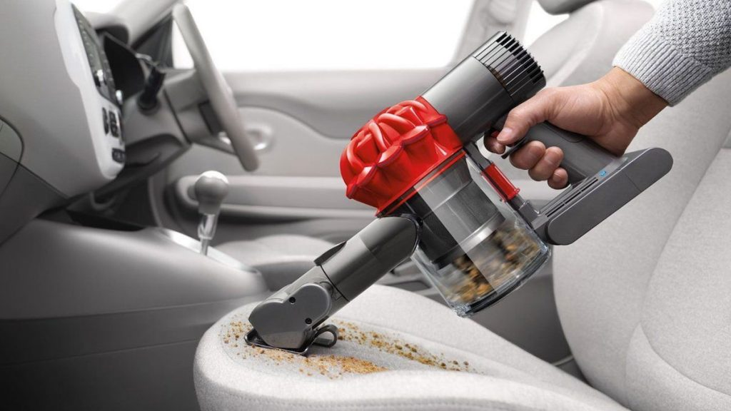 Cleaning leather car seats procedure start with vacuuming